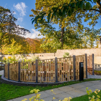 Wooden structures provide a wind-sheild in this garden at CLAN