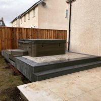 Millboard decking with sunken hot tub