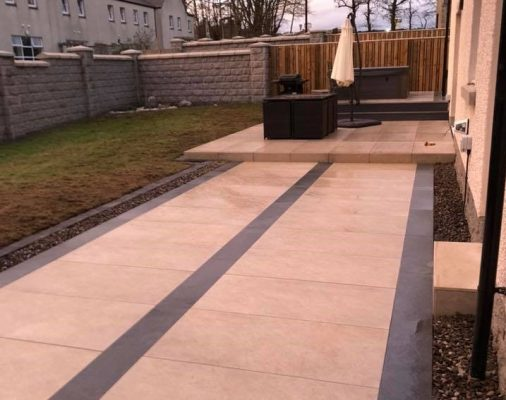 Porcelain patio in cream and grey. Papillon Designs & Landscaping.